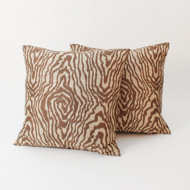 Pair of custom sateen tan-and-light brown fax bois tiger pattern throw pillows with pattern on fronts and backs. Custom...