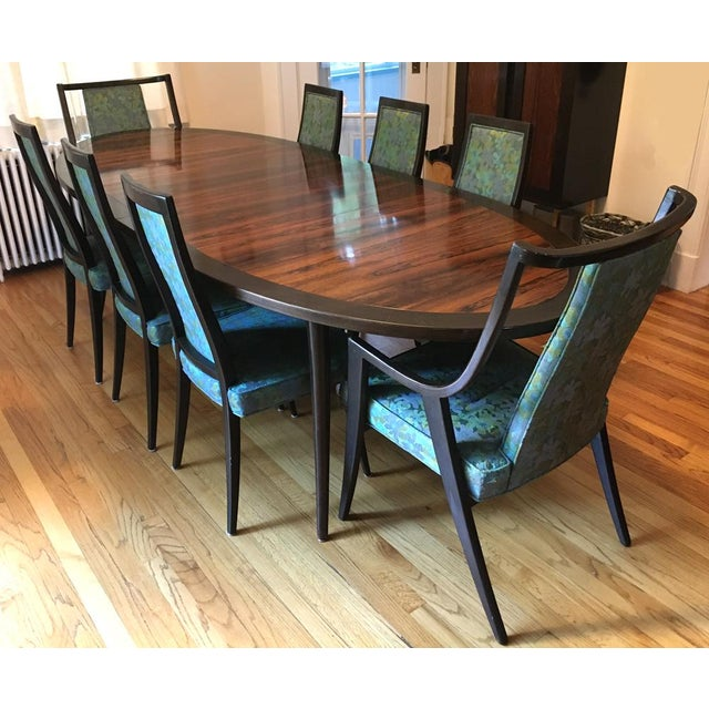 "An oval Harvey Probber ebonized mahogany and rosewood dining table and eight dining chairs. The table is 72"" X 42"" X 29""..."