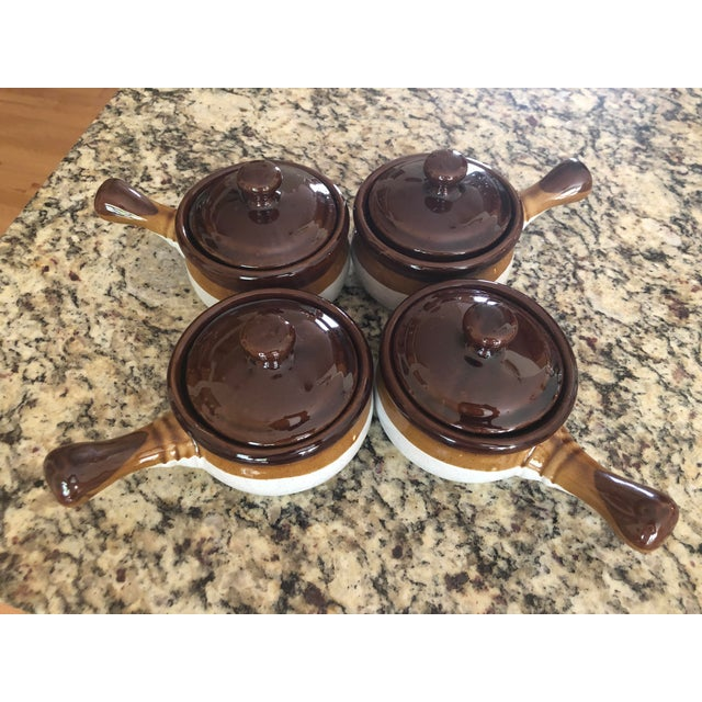 Excellent Pre-owned Condition. This retro set of stoneware crocks with handles and lids belongs to my mom who no longer...