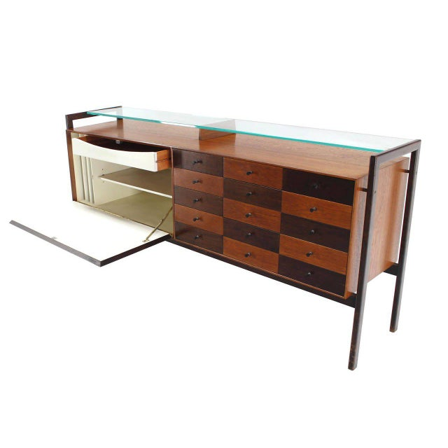 Very unusual glass shelf feature Mid-Century Modern multi drawer long dresser with drop front record or file compartment.