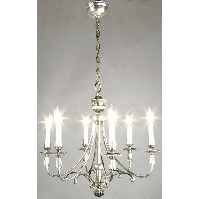 Silver-plated six-arm Regency chandelier from Lightolier. Certain characteristics are similar to the design elements of...