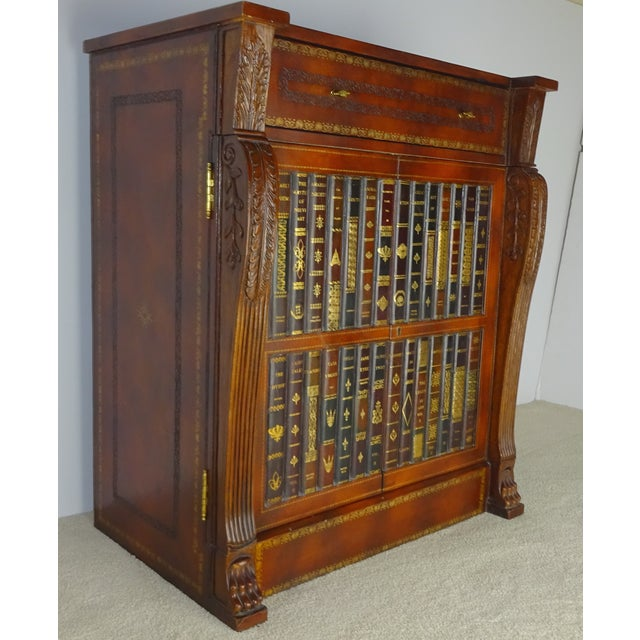 Maitland Smith gilt and embossed leather clad single drawer cabinet with antique book facade.. The old books make a false...