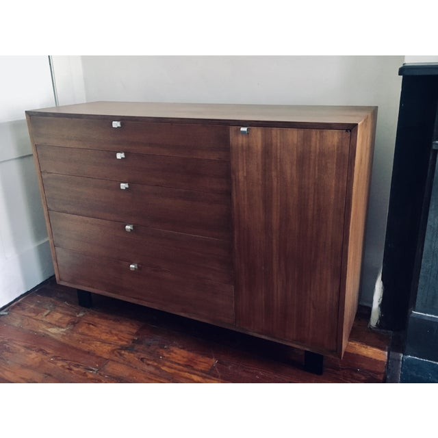 George Nelson five-drawer walnut dresser with side cabinet containing two adjustable shelves, produced by Herman Miller ca...