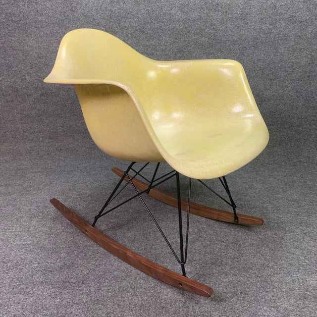 Here is a classic American made fiberglass rocking chair designed by Charles Eames. This early 1950's shell, with its pale...