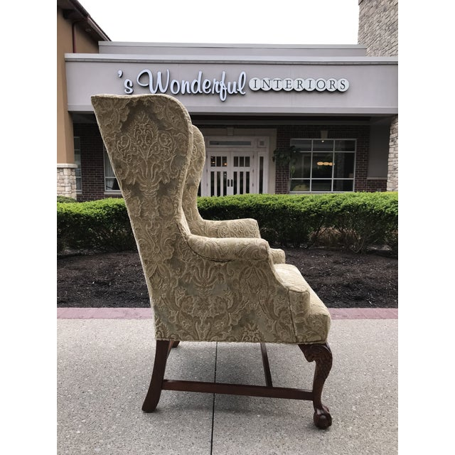 Outstanding Chippendale style Wing Back chair with carved mahogany legs and detailing of a American Eagle classic look...