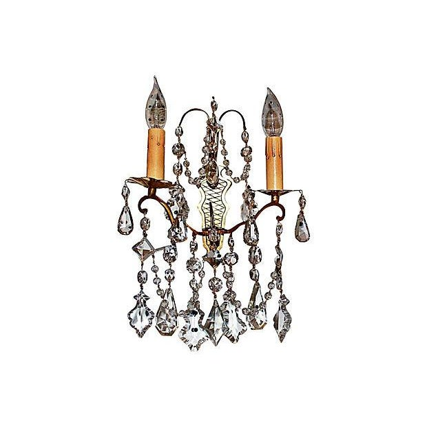 A pair of antique French hand-rubbed gold plated-doré bronze and cut-crystal sconces. Wired and in working condition, take...