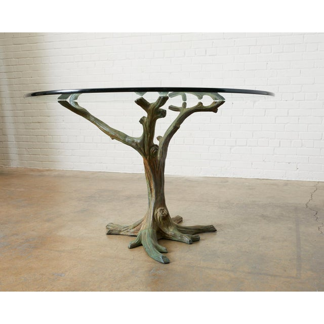 Mid-Century Modern French faux-bois tree sculpture dining table crafted from bronze. Features an applied verdigris finish...