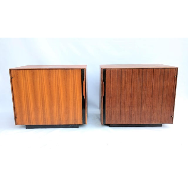 Pair of large 1960s walnut nightstands designed by John Kapel for Glenn of California. These nightstands feature magazine...
