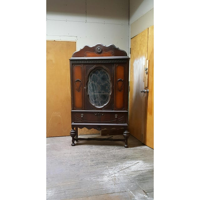An antique art deco waterfall armoire or glass hutch that comes with key! This beautiful vintage china cabinet is in great...
