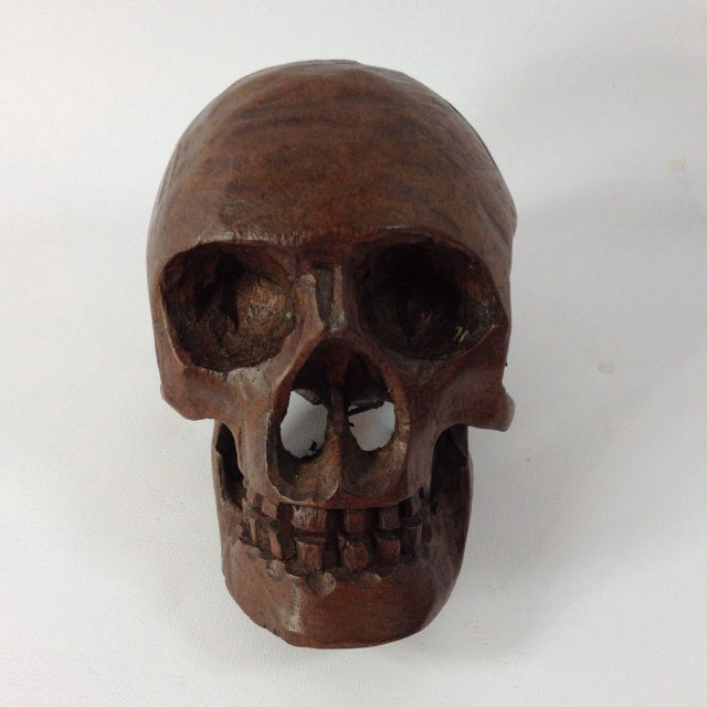 It's not all in your head - this skull is chic! Get a-head of your home decor with this striking wood skull. Mysteriously...
