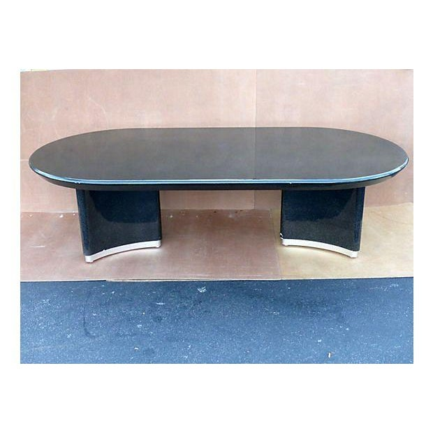 An oval racetrack dining table in the style of Karl Springer. A fine metallic lacquer finish with a double pedestal base...