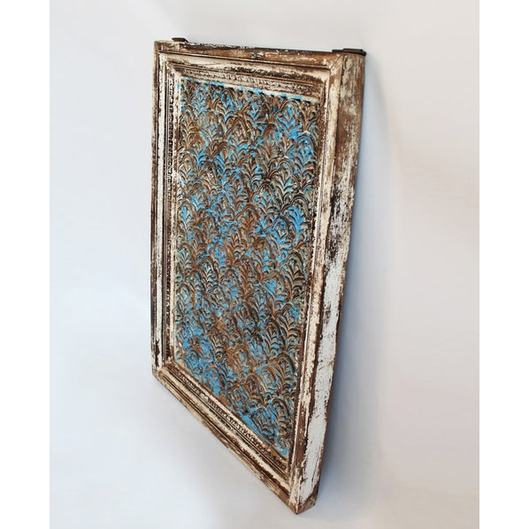 Original hand carved teak wood window screen with beautiful worn blue patina and a white painted frame. From North India.