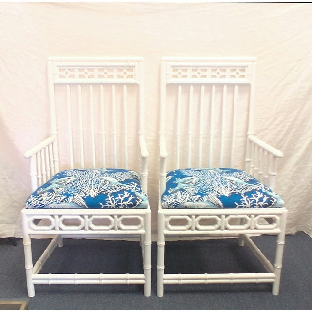 Pair of coastal chic Chippendale occasional chairs. The seats have a blue and white Nautical pattern featuring fish and...
