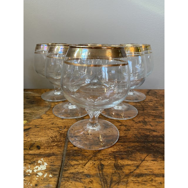 Beautiful Hollywood Regency, gold rimmed snifters for brandy, cognac, bourbon, whisky. Leaf details on the stems. Ring...