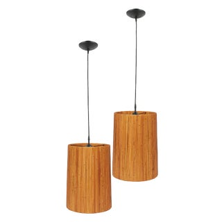 A Pair of Midcentury Tan Pendant Lights