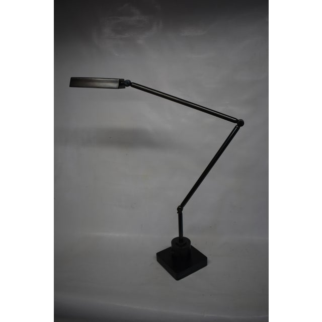 Fully articulated brass and steel LED task lamp designed and fabricated by Oblik studio inc. Blackened steel body...