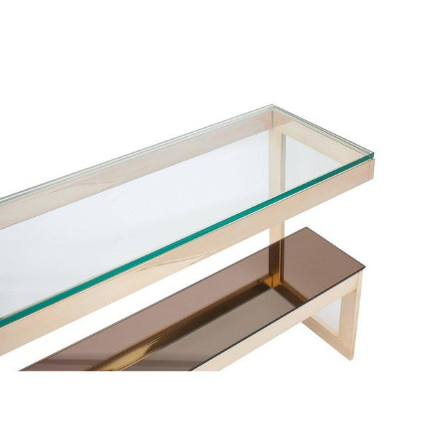Wonderful 24-karat gold layered two tier console table. Belgo Chrome 1980s, Belgium. Smoked glass top. Mirrored smoked...
