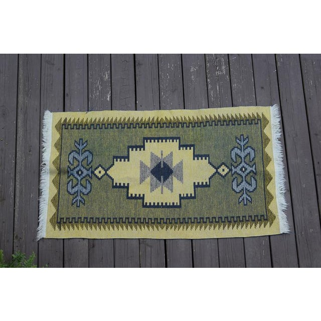 Beautiful gray, navy and yellow Kilim Handmade rug. It is reversible as one side is predominantly navy and the other side...