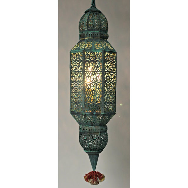 This unique Moroccan style lantern with a verde green finish with a 3-light cluster makes and fun entry light or over an...