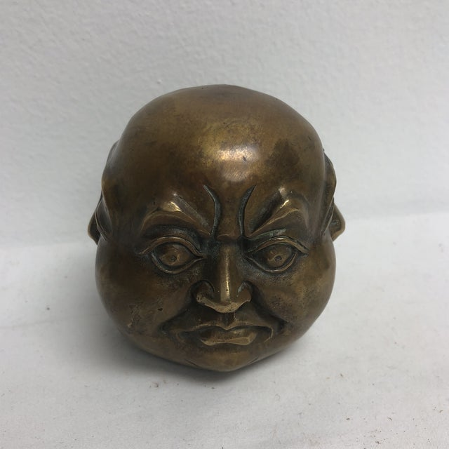 Brass oriental four face Buddha figure with markings on bottom.
