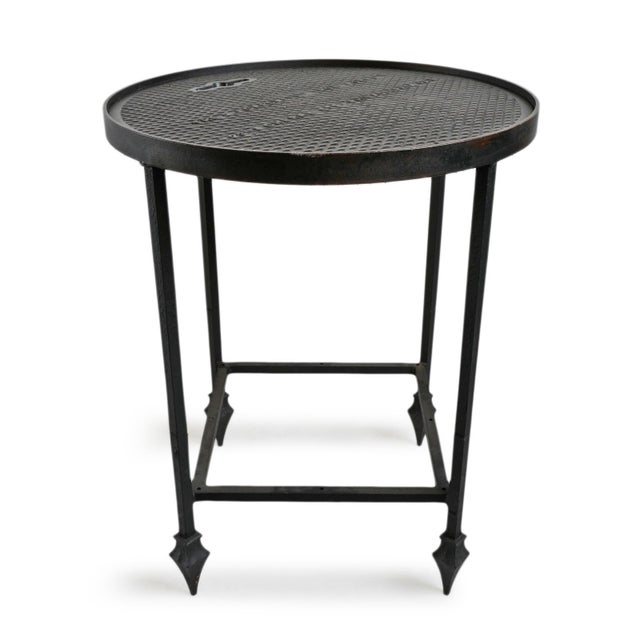 """Industrial cast iron manhole repurposed into a useful side table with optional thick glass top. Text on manhole reads """"The..."""