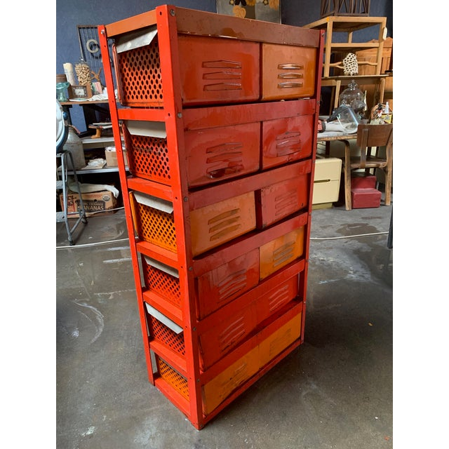 Vintage orange 10-basket metal locker set—functional and colorful! Makers. Organize your workshop with statement storage....