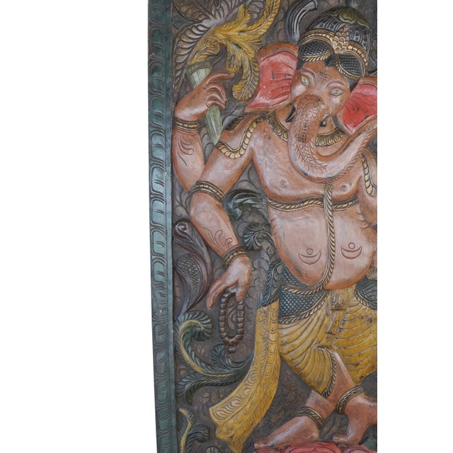 Indian carved wood wall panels of Lord Ganesha creates obstacles on our path and also removes the same following worship....