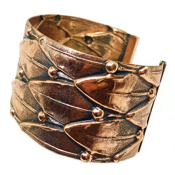 """Circa 1950s Renoir copper cuff with a repossé leaf design. The interior circumference measures 6.75"""" and is adjustable, by..."""