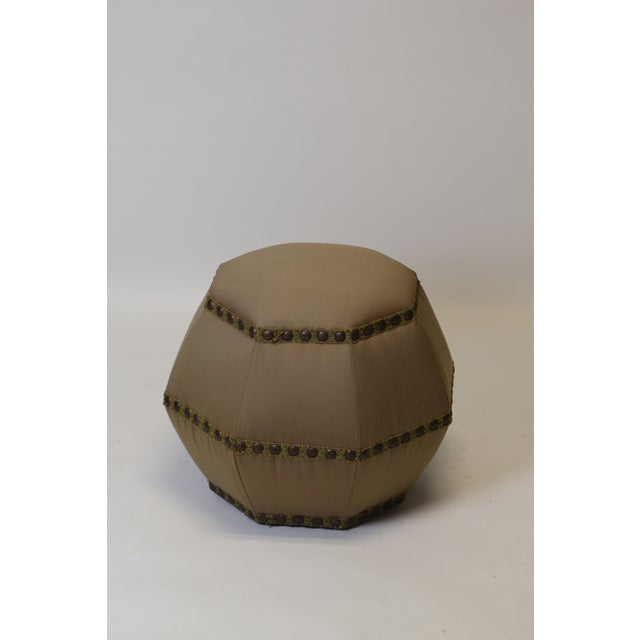 Curious octagonal ottoman. This is a wonderful ottoman with a unique shape. Can easily be placed in a living room for...