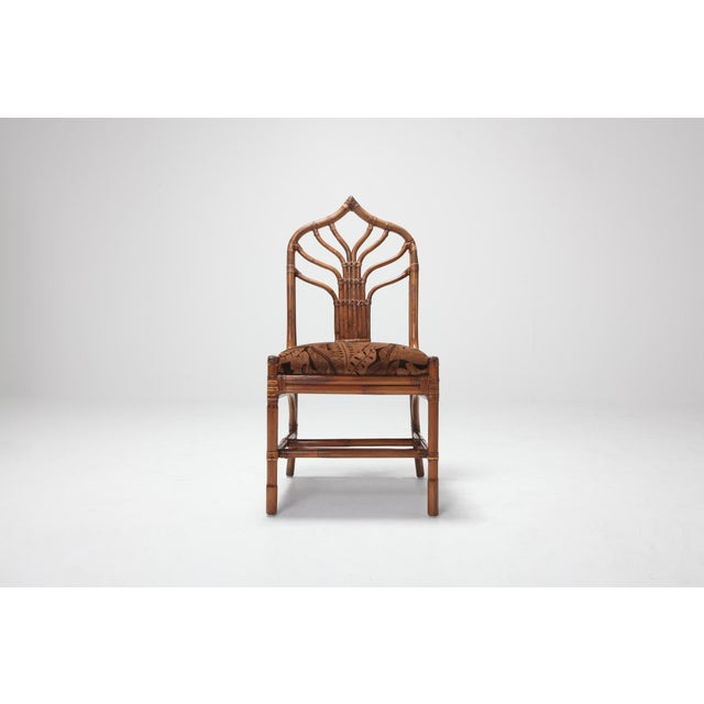 Sculptural Italian bamboo dining chairs with floral original upholstery. A set of 6 with 4 chairs and 2 armchairs. Italy,...