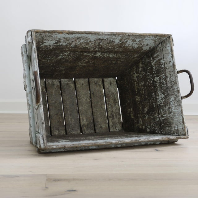 Distressed wood painted firewood box with iron handle. Sturdy, crusty and very useful.
