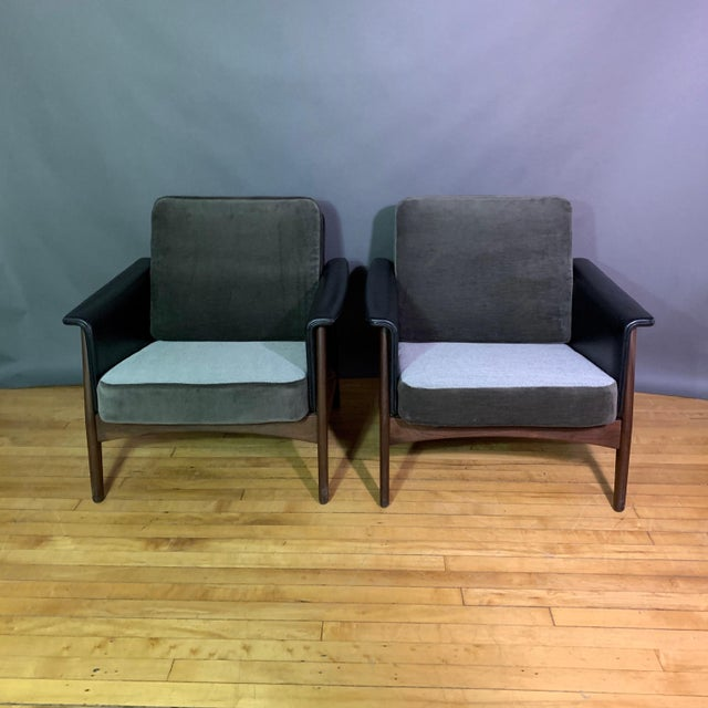 A pair of nicely proportioned lounge chairs in the Danish mid-century tradition with flared arm in the Hans Olsen style....