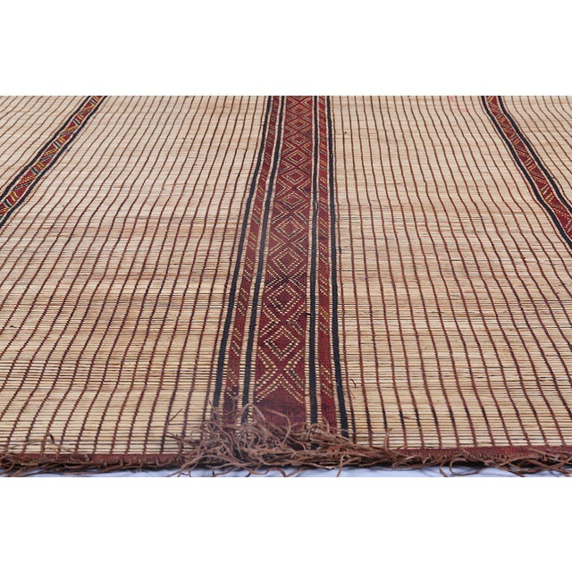 """A very beautiful vintage African rug stitched with Tuareg reed and camel leather. Dimensions are 12' X 14'5"""""""