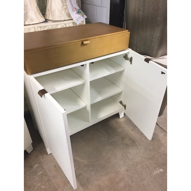 Contemporary White and Gold Drexel Nightstand. Drawer on top and cabinet on bottom with shelves for plenty of storage.