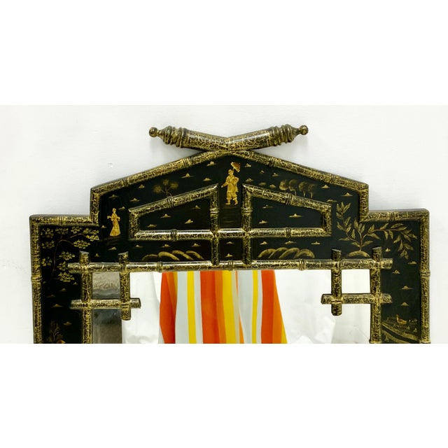 This is unique carved and painted wooden chinoiserie mirror with faux bamboo styling. It is unmarked.