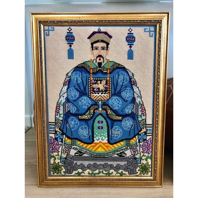 A pair of vintage framed Chinoiserie needlepoints. These needlepoints depict traditional Chinese Ancestor Portraits or...