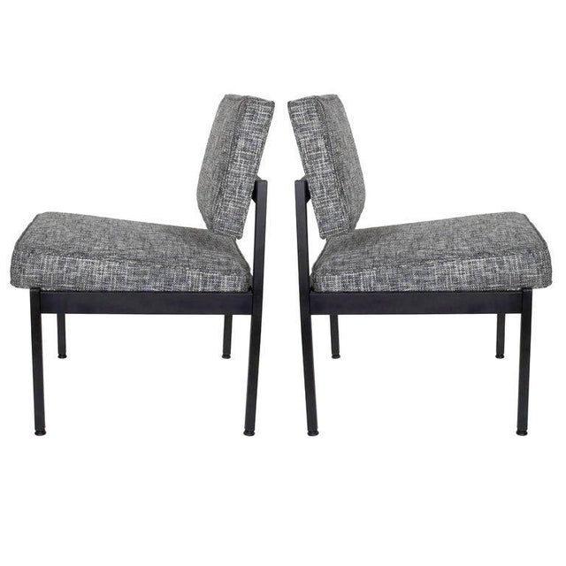 Pair of upholstered Mid-Century Modern industrial style chairs with floating seat and back cushions. Fine example of...