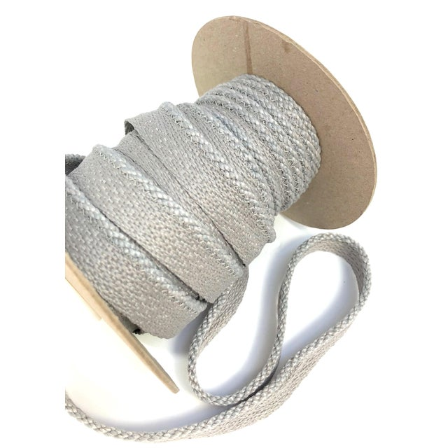 """One 14 yard spool of 1/8"""" cabled cord with flange. Flange is 1/2"""""""" wide for sewing into upholstery. Total height of this..."""