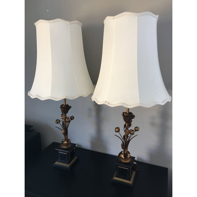Offered is a pair of mid-century Italian gilt tole metal lamps. Includes newer silk shades. Height given to top of shade,...