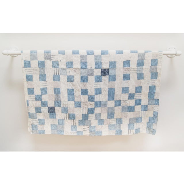 This fantastic quilt throw blanket is a patchwork various blue and ivory cotton khadi fabrics top stitched in ivory cotton...