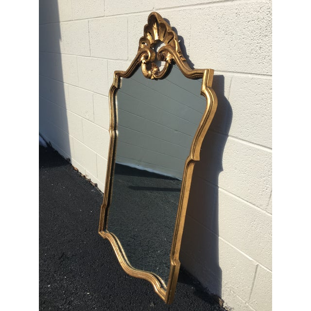 Large, ornate hand-carved gilt wood mirror. A stunning mirror with beautiful scallop and scroll details. This is a...