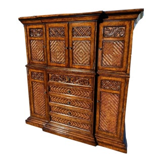 Tommy Bahama Solid Wood Carved Front Wicker Two Piece Armoire For Sale