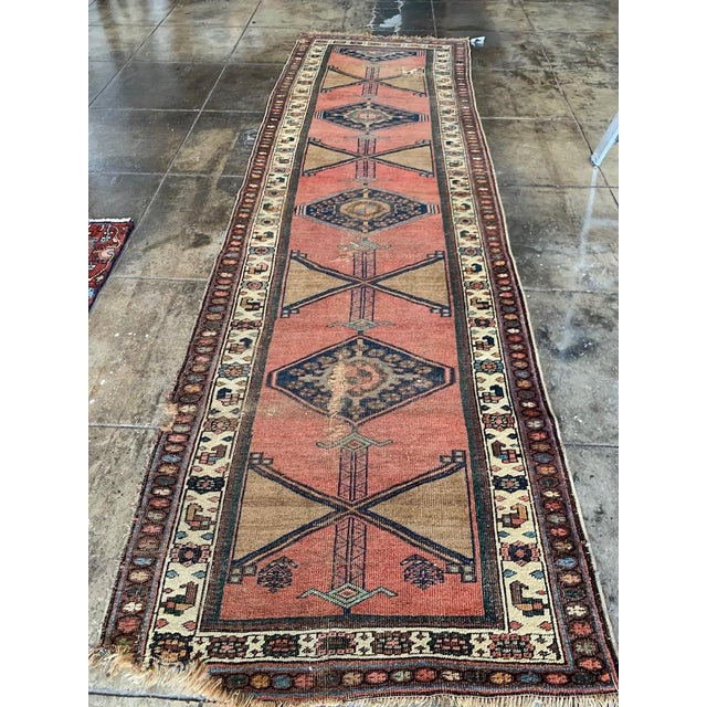 Antique fading and wear give this runner a distinct character. probably turn of the century or older. can be repaired