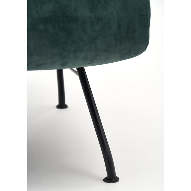 A dynamic Italian pair of armchairs by Carlo di Carli. This pair has deep teal velvet upholstery and are strongly...
