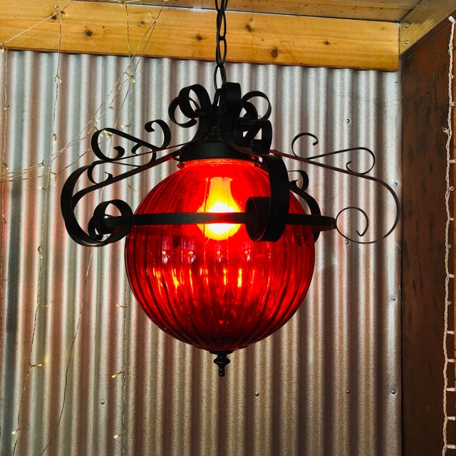 Fantastic Vintage Red 70's Swag Lamp. A great red color. Perfect for a retro room or even on a patio. Has some scratches...
