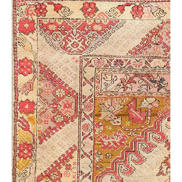 Here is an absolutely beautiful antique Oriental rug - an antique Ghirodes composition that was originally woven in Turkey...