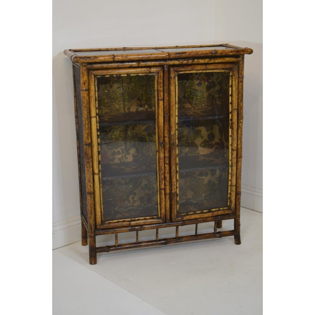 """Wonderful 19th-Century Victorian Bamboo Bookcase with two (2) doors. """"Faux Tortoise Shell"""" finish. Chinoiserie top...."""