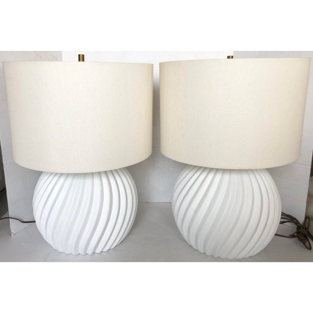 Great pair of white gesso swirl table lamps. Original working wiring. Each takes a standard bulb 75w max. Shades and harps...