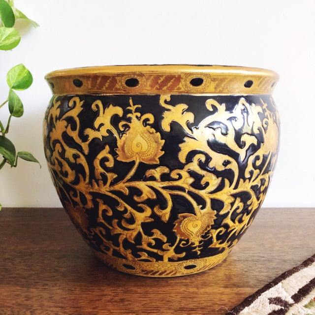Vintage hand- painted Satsuma ceramic pot with striking black and gold exterior paint. The interior features intricate...