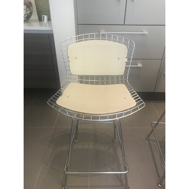 Two Knoll Harry Bertoia counter stools purchased 2003 . Both stools are in very good condition. Cream tone cowhide seat...